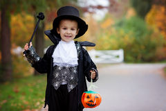 Cute boy in the park, wearing magician costume for Halloween Royalty Free Stock Image