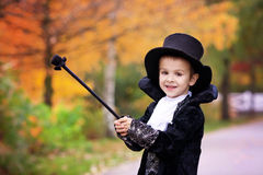 Cute boy in the park, wearing magician costume for Halloween Stock Image