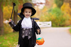 Cute boy in the park, wearing magician costume for Halloween Stock Photo