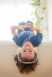 Cute boy with phone and head phones, listening music Royalty Free Stock Image