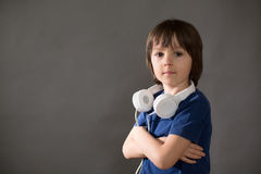 Cute boy with phone and head phones, listening music Stock Images