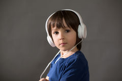 Cute boy with phone and head phones, listening music Stock Photography