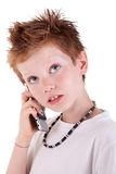 Cute boy on the phone,looking up Royalty Free Stock Images
