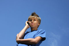 Cute boy phoning with his cell phone Stock Photos