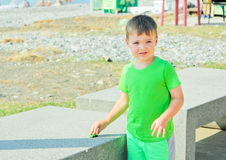 Cute boy plaing with toy car on the beach Stock Photography