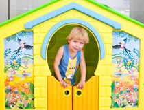 Cute boy in play house Royalty Free Stock Photos
