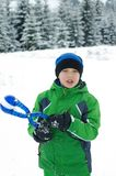 Cute boy play outdoors in snow. Happy boysl playing on a winter walk in nature royalty free stock photo