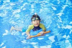 Cute boy playful on the pool 1 Stock Photos