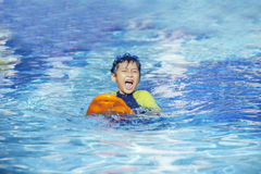 Cute boy playful on the pool 2 Royalty Free Stock Photo