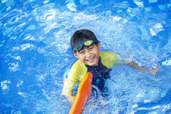 Cute boy playful on the pool Royalty Free Stock Photos
