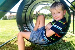 Cute boy in playground Stock Image