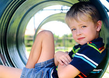 Cute boy in playground Stock Images