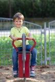 Cute boy on the playground, having fun Stock Photos