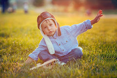 Cute boy, playing with airplane on sunset in the park Stock Photography