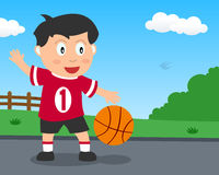 Cute Boy Playing Basketball in the Park Stock Photography