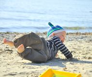 Cute boy playing on a beach Stock Images
