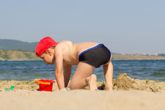 Cute boy playing on the beach Royalty Free Stock Photo