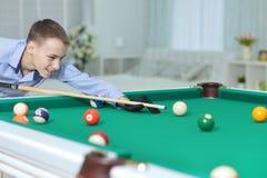 Cute boy playing billiard Royalty Free Stock Photo