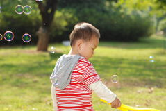 Cute boy playing bubbles Stock Images
