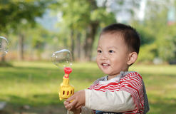 Cute boy playing bubbles Stock Photo