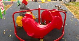 Cute boy playing on carousel
