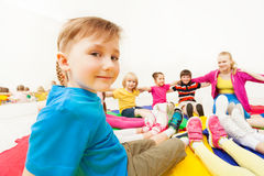 Cute boy playing circle games with friends in gym Stock Photo