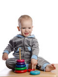 cute boy playing with color pyramid toy Royalty Free Stock Images