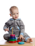 cute boy playing with color pyramid toy Stock Photo