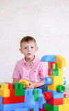 Cute Boy Playing with Colored Plastic Block Toys Royalty Free Stock Images