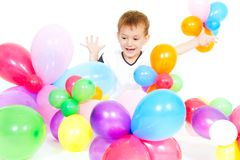 Cute boy playing with colorful ballons Royalty Free Stock Photos