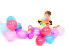 Cute boy playing with colorful balloons Stock Photo