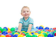 Cute boy playing colorful balls isolated Stock Photos