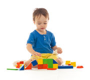 Cute boy is playing with colorful building blocks stock photos
