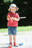 Cute boy, playing croquet Royalty Free Stock Photo