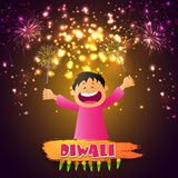 Cute boy playing with firecrackers for Diwali. Cute little boy playing with firecrackers on occasion of Diwali festival, Glowing holiday background for Indian Royalty Free Stock Image