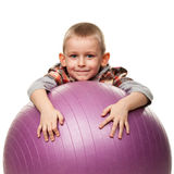 Cute boy playing with fit ball Royalty Free Stock Photography