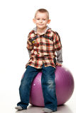 Cute boy playing with fit ball Stock Images