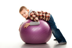 Cute boy playing with fit ball Stock Photography