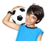 Cute boy playing football royalty free stock photos