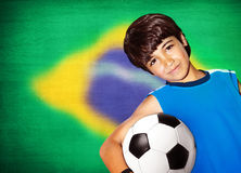 Cute boy playing football Stock Images
