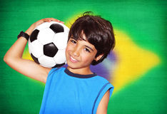 Cute boy playing football Royalty Free Stock Images