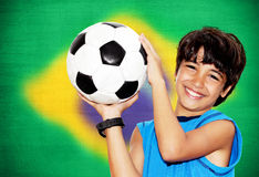 Cute boy playing football royalty free stock photo
