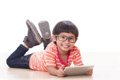 Cute boy playing a game Stock Photography