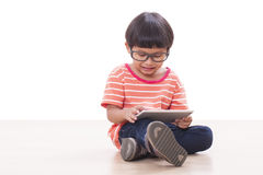 Cute boy playing a game Royalty Free Stock Image