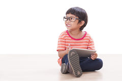 Cute boy playing a game Royalty Free Stock Photography