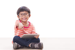 Cute boy playing a game Royalty Free Stock Images