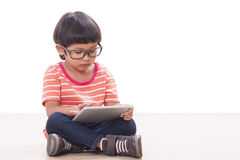Cute boy playing a game Royalty Free Stock Photos