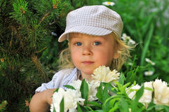 Cute boy playing in the garden stock photo