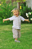 Cute boy playing in the garden royalty free stock photography