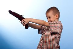 Cute boy playing with the gun Royalty Free Stock Photo